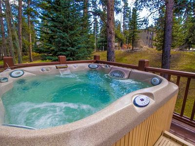 Photo for Private outdoor hot tub / updated interior / close to summer hiking & biking