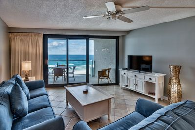 living room area with 2 couches large flatscreen tv and gulf view