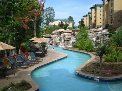 300' lazy river/ flows around the flowery island landscape/mount rock water fall