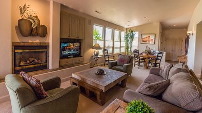 Great Room With Cozy Gas Fireplace And Flat Screen TV