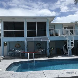 Photo for Sea Breeze Heated Pool Home 3 Br, 3bath, 75' Dock And Quick Ocean Access.