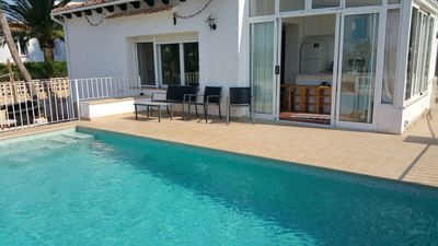 The swimming pool and the entrances to the house