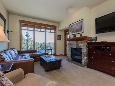 Photo for Charming condo with easy ski access, year-round outdoor pool, hot tub, fitness center and free parki