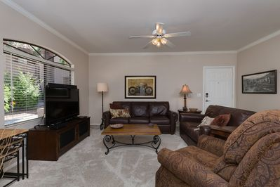 Living area with quality leather seating, HDTV and fireplace.