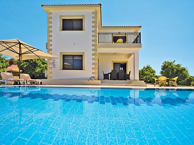 Photo for Hillside villa w/ countryside views, modern appliances, pool + air con