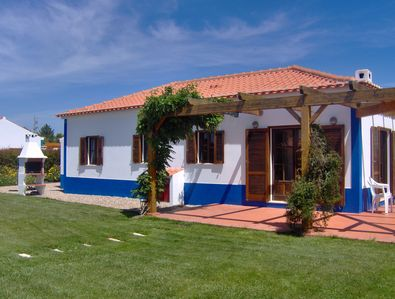Rear of Villa 6 and garden, with BBQ and patio area.