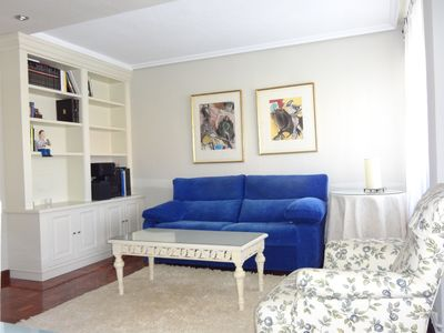 Photo for Sunny apartment close to the University with parking and wifi