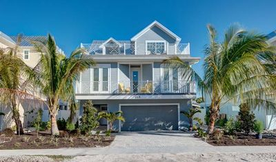 Photo for BOOK YOUR 2020 SUMMER STAY TODAY!! BEAUTIFUL LUXURY HOME ON ANNA MARIA'S NORTH END! CLOSE TO THE BEACH!! ROOF TOP DECK AND HEATED POOL AND SPA! WALKING DISTANCE TO BEACH! DON'T MISS OUT!!!