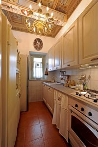 Photo for Apartment in a historic building with high painted coffered ceilings