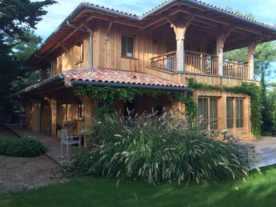 Photo for Beautiful wooden house 200 m from the ocean between Phare and Pointe Cap Ferret