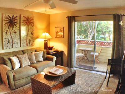 Living room has lanai and golf course and green space views.