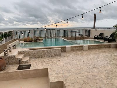 Photo for Stunning Beachfront property with resort style pool!