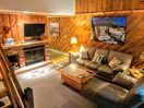 Living room w/ wood burning fireplace and flat screen tv