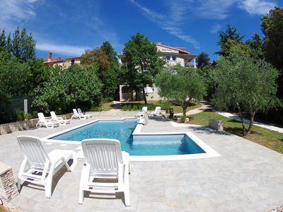 Photo for Family house with 12 apartments, shared pool, 200m from the beach