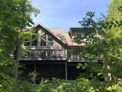 Photo for Lake front home located on a small cove with a semi private dock
