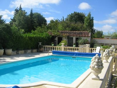 Photo for Charming comfortable cottage in the heart of Golden Saintonge. Heated pool