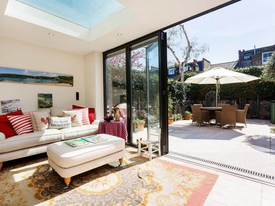 Photo for Beautiful English house with charming courtyard garden in elegant Fulham (Veeve)