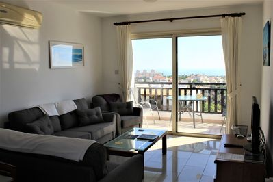 Lounge with patio doors opening on to the terrace with view s of the Med.