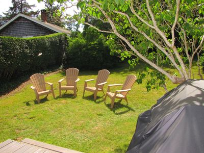 Relax on the adirondack chairs, large grassy yard