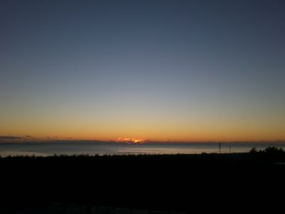 Have your morning coffee and watch the sun rise on ocean.