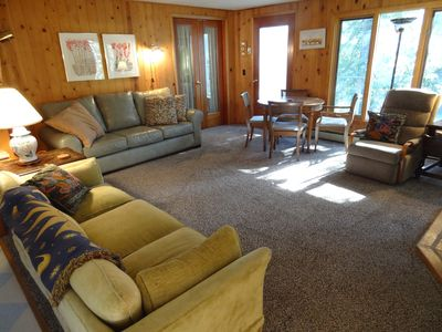 Newly carpeted living room opens to kitchen/ dining. Lots of games and puzzles.