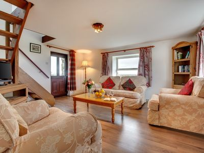 Photo for This cosy and secluded cottage is ideally located for your Pembrokeshire holiday. Set on a working f