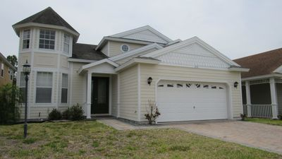 Photo for 5/5.5 luxury pool home in gated Victoria Woods at Providence Resort. Community playgrounds, champion