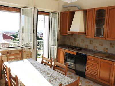 Photo for Apartment 1.9 km from the sea with sea view and garden with barbecue