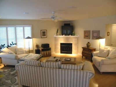 Living area with comfortable Lazy Boy furnishings, large TV, surround sound, DVD