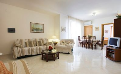 Photo for Lovely, large apartment near Lido beach & old town with wifi and aircon