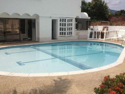 Photo for Large home in Melgar with private pool, outdoor bar, BBQ & more