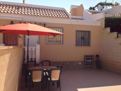 Photo for Townhouse with garden, communal pool, BBQ area very close to all amenities