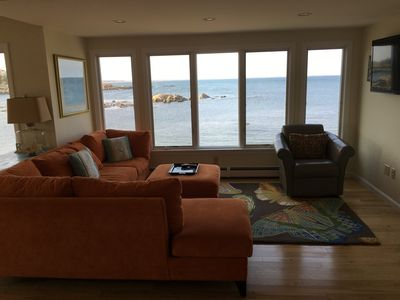 Oceanfront living room with updated furnishings and flatscreen HDTV.