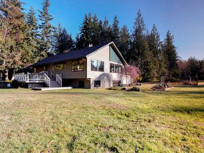 Photo for Peaceful and family-friendly home in private meadow with wood-burning fireplace!