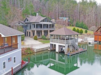 Photo for NEW! Luxury lakefront home w/pool table & indoor/outdoor fireplaces - dogs ok!