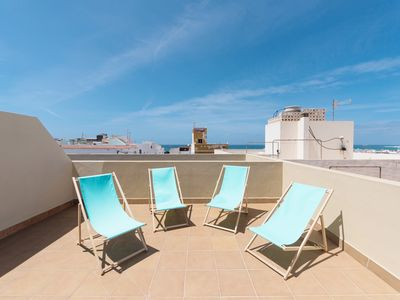 Photo for Rooftop terrace & private balcony. Town center & 200m to beach. CasaCotillo. es