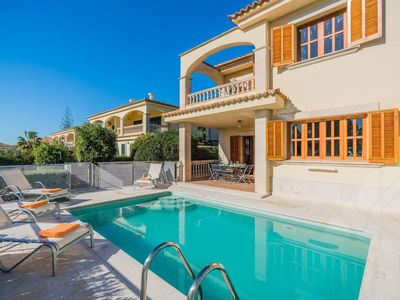 Photo for 4 bedroom Villa, sleeps 8 in Port d'Alcudia with Pool, Air Con and WiFi