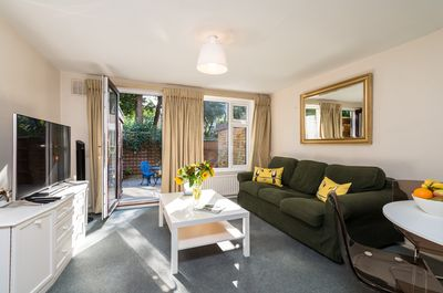 Sitting room with smart 4G TV, DVD and king sofa bed. Leads onto paved  garden