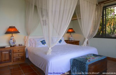 Photo for WHIMSICAL CONDO WITH A STUNNING VIEW TO ZIHUATANEJO BAY