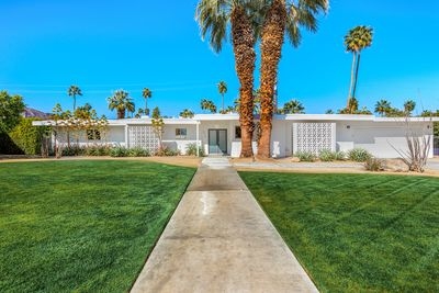 Classic mid century curb appeal with enormous lawn