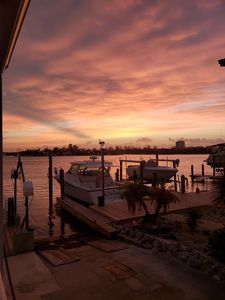 Photo for Two Docks and Open Water View, Beautiful Sunrises over Bonefish Bay