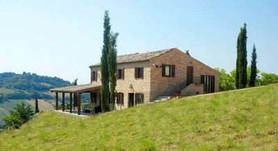 Photo for Villa with private heated pool and spectacular views of the Italian countryside