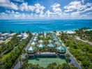 Arial view of tennis court and property to the Atlantic Ocean