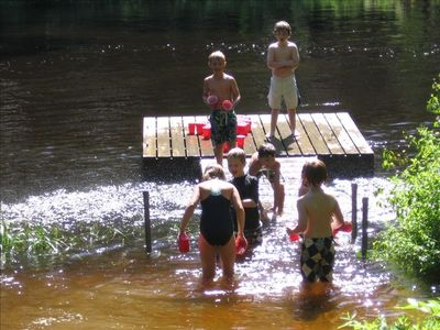 Children playing at the dock.