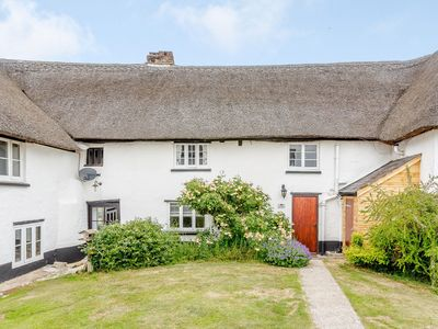 Photo for Charming thatched farmhouse cottage with amazing on-site facilites