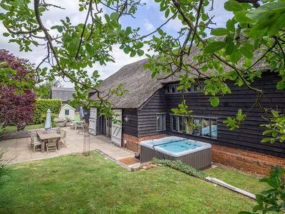 Photo for This beautiful, converted barn sleeps 14 and has access a hot tub and pool.