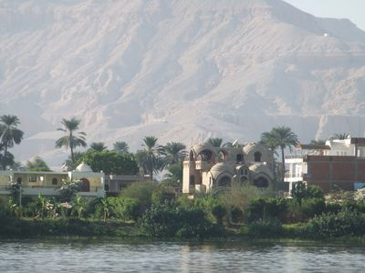 Riverbank House with mountains containing the Valley of the Kings