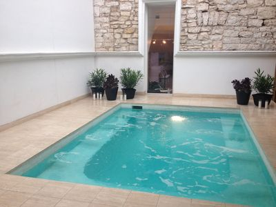 Indoor heated pool with the 1880's original stone wall in background.