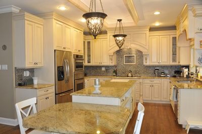 Custom kitchen with wine fridge and walk-in pantry