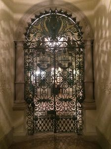 Ornate wrought iron gate in entryway.